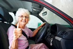 Canfident driving grandma Stock Photos