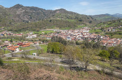 Cangas de Onis. Asturian fields situated in the mountains of Asturias in the north of spain, you can see the village of Cangas de Onis with the mountains in the Royalty Free Stock Photography