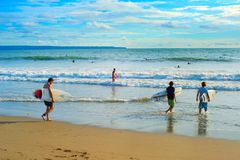 Surfing on Bali. Many surfers Royalty Free Stock Image