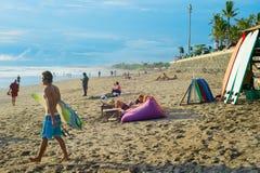 People at sunset Bali beach stock photo