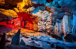 Cango Cave of South Africa. Cango Cave, amazing view on stalactites in colorful bright light, beautiful natural attraction, wonderful nature, touristic place Royalty Free Stock Photos