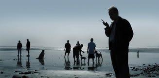 Cani e la gente Immagine Stock