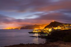 Canical at dusk/night, Funchal city in the background, Madeira, Portugal stock photos