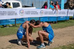 World Mountain Running Championships Race Finish - Italy celebrate achievement with a prayer royalty free stock photography