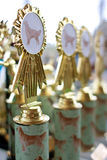 Canine Themed Trophies Sit On Display At Dog Festival Stock Images