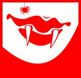 Canines of the vampire. Smiling lips of the vampire with sticking out canines and spider Stock Photography