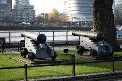Canions Defending the Thames. Shore next to the London Bridge stock image