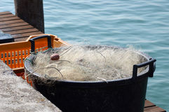 Canister with fishing net. On sea waves Stock Photography