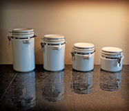 Canister Reflections. A set of canisters reflect onto an expensive polished stone counter royalty free stock image