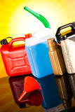 Canisters, Liquids for car on vivid moto concept Royalty Free Stock Photography