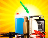 Canisters, Liquids for car on vivid moto concept Stock Photography