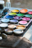 Canisters Of Oil Paints At Carnival Face Painting Station Royalty Free Stock Photo