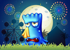 A canival with a blue monster crying Royalty Free Stock Photos