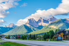 Morning view at the Three Sisters mountains in Canmore - Canada. CANMORE,CANADA - JULY 1,2018 - Morning view at the Three Sisters mountains in Canmore. Canmore stock images