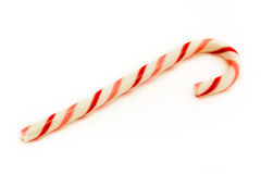 Canna cany a strisce rossa e dentellare sopra bianco Fotografia Stock