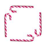 Canna di caramella su priorità bassa bianca Fotografie Stock