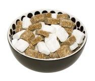 Canna scura e zucchero bianco Immagini Stock