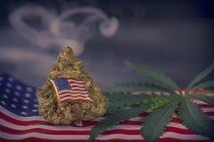 Cannabis bud, leaf and american flag with smoke  - veteran medic. Cannabis bud, leaf and american flag with smoke and copyspace - veteran theme medical marijuana Stock Photography