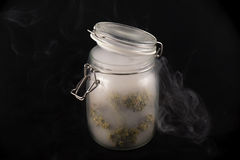 Cannabis buds maui skunk strain on a glass jar with smoke isol Stock Photography