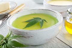 Cannabis Butter. Delicious homemade cannabis butter with marijuana leaf garnish stock image