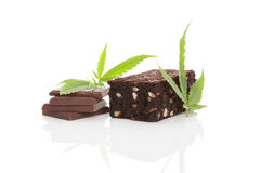 Cannabis chocolate and brownie. Cannabis chocolate and cannabis brownie with ganja leaf on white background Stock Image