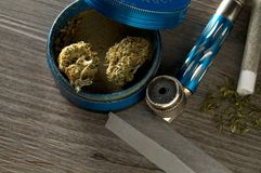 Cannabis, Grinder, Pipe, Joint and Paper on Table. Horizontal Image stock photo