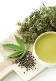 Cannabis healing natural ointment and marijuana leaf and seeds Stock Image