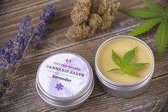Cannabis hemp cream with marijuana leaves, lavender and nugs on stock photos