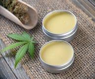 Cannabis hemp creams with marijuana leaf and nugs royalty free stock image