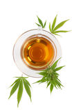 Cannabis herbal tea. Cannabis herbal tea with cannabis leaves on white background from above. Natural remedy, medical marijuana stock photos
