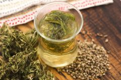 Cannabis herbal tea. On wooden background royalty free stock images