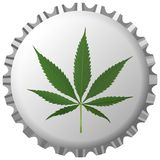 Cannabis leaf on bottle cap against white Royalty Free Stock Image