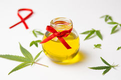 Cannabis leaves and oil on white Royalty Free Stock Photo