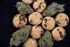 Cannabis nugs and infused chocolate chips cookies - medical mari stock photos
