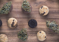 Cannabis nugs over infused chocolate chips cookies - medical mar Royalty Free Stock Photography
