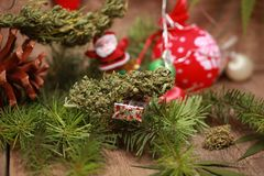 Oil cannabis in a bottle and hemp on a christmas background royalty free stock image