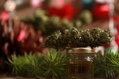 Oil cannabis in a bottle and hemp on a christmas background stock images