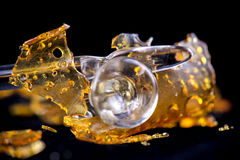 Cannabis oil concentrate aka shatter with glass tools isolated stock photos