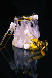 Cannabis oil container and quartz crystal isolated on black. Detail of cannabis oil container and quartz crystal isolated on black - medical marijuana concept Stock Image