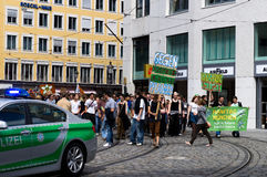 Cannabis rally. MUNICH, GERMANY - JULY 7: People holding banners debate for a cannabis legalization while passing along the street accompanied by a police July 7 Royalty Free Stock Images