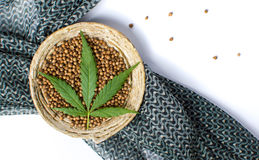 Cannabis seeds in a bowl with dark fabric. On white stock photography