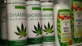 PRAGUE, CZECH REPUBLIC, SEPTEMBER 9, 2019: Cannabis shower oil gel shampoo vitamins shop or store Prague, packaged hemp
