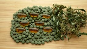 Cannabis tablets medical capsules seeds big bud bunch dry dwith pistils or pills