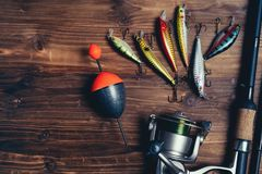 Canne à pêche de sports d'art et fond d'attirail photo stock