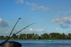 Canne da pesca sulla banchina Fotografie Stock Libere da Diritti