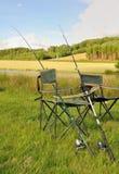 Canne da pesca sulle sedie Immagine Stock