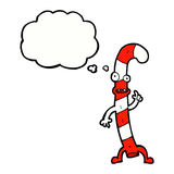 canne de sucrerie de Noël de danse de bande dessinée avec la bulle de pensée Photos stock