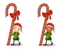 Canne de sucrerie de transport d'elfe Photographie stock libre de droits