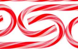 Canne di caramella su bianco Immagine Stock