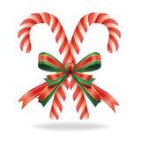 Canne et ruban de sucrerie de décoration de Noël. Photographie stock libre de droits